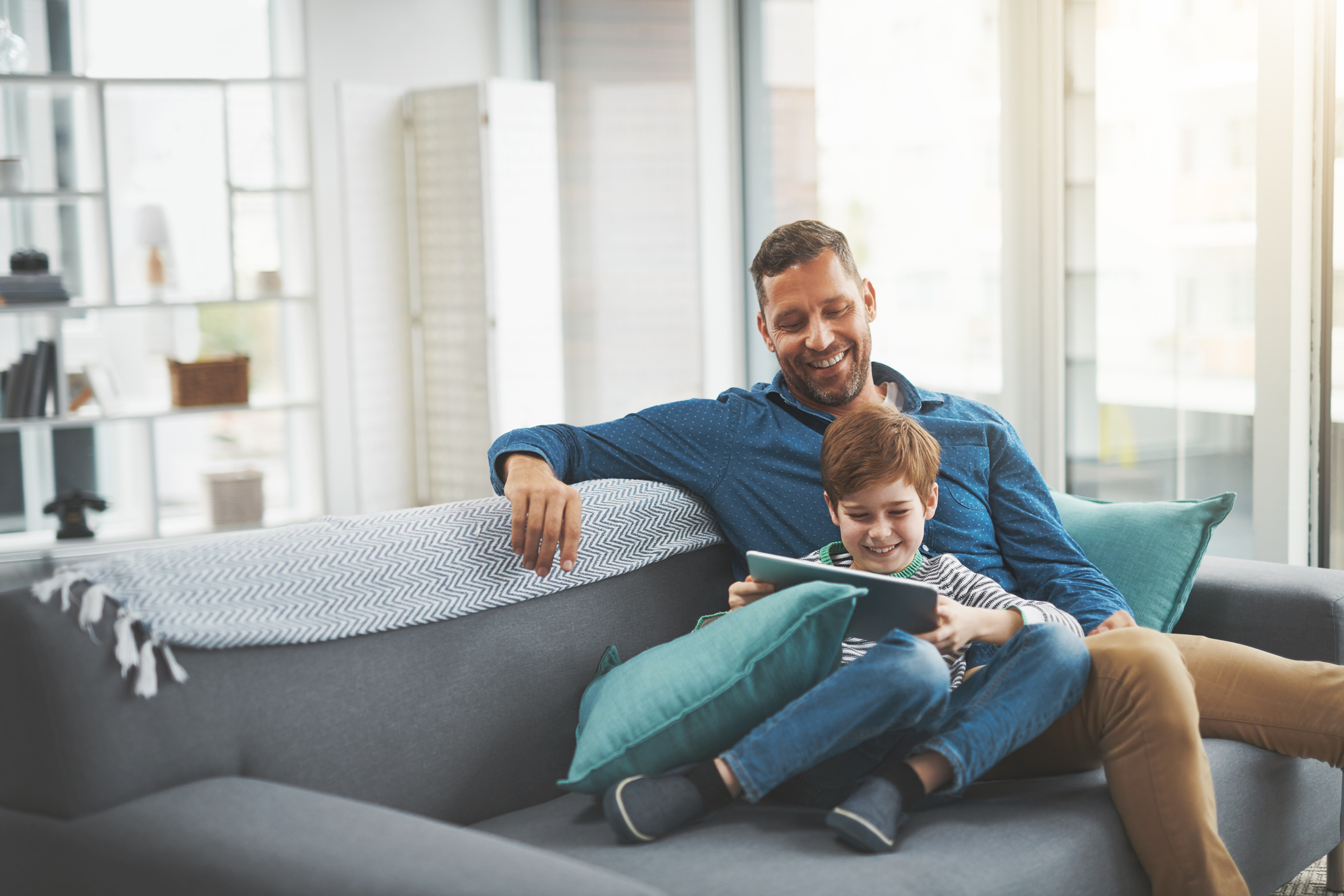 image of father and young son using tablet