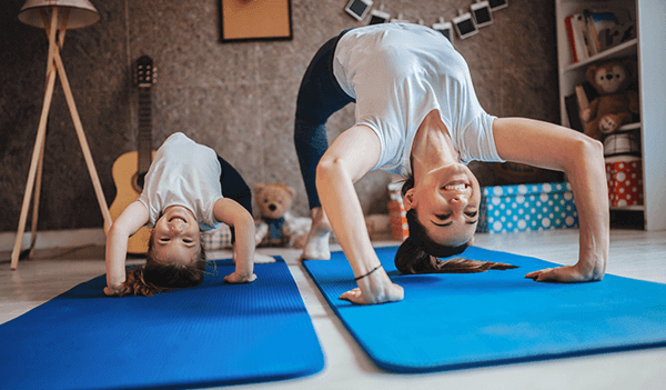 Mum and daughter exercising together